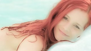 Underwater posing by busty Ariel