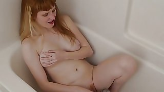 Red Haired Daphne Plays In The Bath Tube