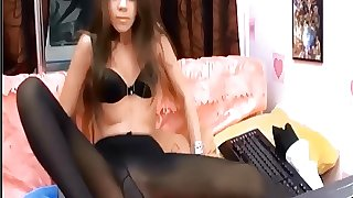 Teen at home in black pantyhose