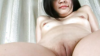 Naked and handsome solo girl is showing her shaved cunt