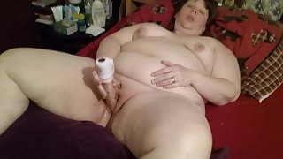 Wife playing with toy.