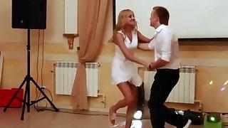 Peeking up her skirt during a dance