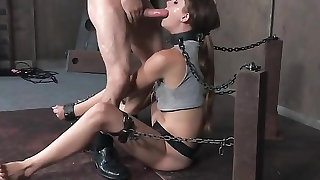 Thick metal collar and chains on a sub slut