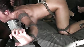 Great rope bondage of a spit roasted girl