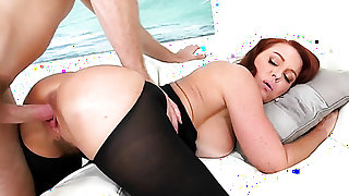 Redhead Janet Mason with massive tits gets her