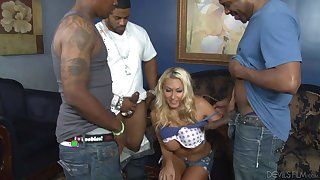 Katie Summers blows three big black cocks
